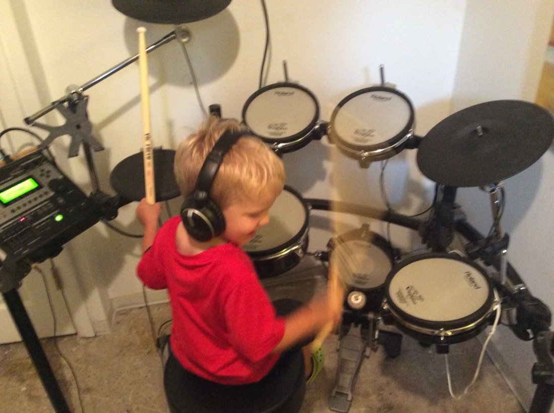 Mason Playing V-Drums
